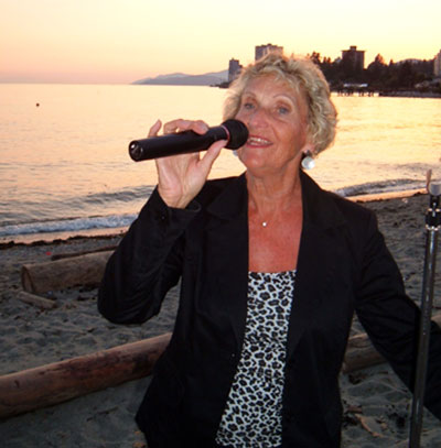 Gwen Gouchée performing at a beach party.